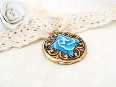 Polymer Clay Antique brass blue flower Pendant by jewelryfimo, $45.00