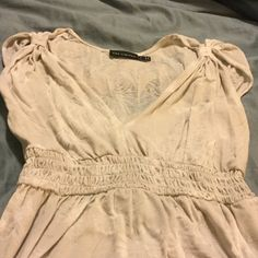 SALE! Printed summery Limited shirt Gently used condition-lightweight sleeveless Limited shirt with subtle printed flower pattern. The flowers are see through (shown in 2nd pic), so a cami is needed for underneath. The Limited Tops Tank Tops