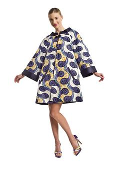 TRAPEZ COAT PURPLE  reversible coat    Ultra-stylish REVERSIBLE trapezium shape coat made from batik and cotton, with two side pockets. We dressed it up with a chic braid at the collar. One side is plain, the other reverses to a pattern; wear it either way for versatility. The trapezium style gives an optical slimming effect and flatters all body types. In 3 different color versions.    TIP: For larger bra sizes M'OYO recommends going one size up.  moyo.com.pl