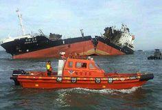 South Korean Coast Guard boat cruises near the broken cargo Doola No. 3