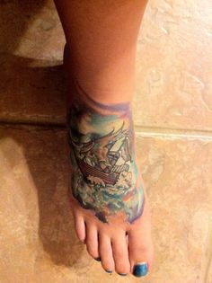 Cool foot tattoo. I especially like the shades of blue and violet.