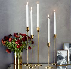 For the Dining Room - Update your dining ambiance with a bundle of of polished brass candlesticks, guaranteed to outlive that bouquet. Brass Candlesticks from RH Candlestick Crafts, Candlesticks, Candle Stand, Candle Holders, Polished Brass, Solid Brass, Chandeliers, Home Furnishing Stores, Tulips