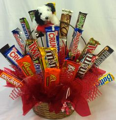 A fun candy bouquet with a little plush puppy on top!