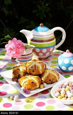 Hot Cross Buns & Coloured Easter Eggs On Table Laid For Coffee ...