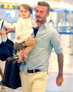This is called a perfect husband and father <3 David Beckham