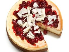 White Chocolate-Cranberry Cheesecake : This festive cheesecake gets an extra dose of sweetness with the help of white chocolate in the filling. Up the ante by reserving some of the white chocolate shavings to decorate the top.