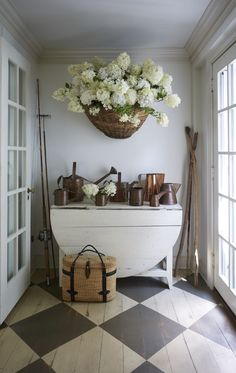 Nora Murphy country house entry with checkerboard pattern flooring, dropleaf table, and huge basket of hydrangea and collection of watering cans. Nora Murphy Country Style to Inspire! #noramuphy #countrystyle #entry #countryhouse #americanfarmhouse #farmhousestyle #rusticdecor French Farmhouse, Modern Farmhouse, Modern Country, Country Style Homes, Farmhouse Style, Farmhouse Decor, Country Houses, Cool Ideas, Country Decor