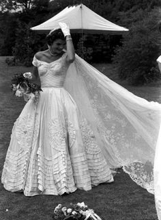 "Jacqueline  ""Jackie"" Kennedy...wore a voluminous ivory silk taffeta gown by the designer Ann Lowe when she married John F. Kennedy in 1953."