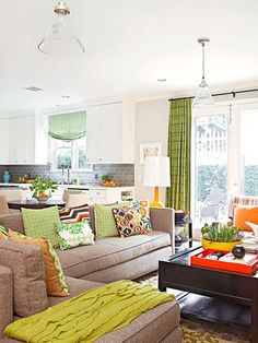 the simplest way to mix and mingle your geometrics, stripes, prints, or floral patterns is to keep them in the same color palette.  The vibrant textile pillow in the center incorporates the citrus shades from other room accents to create a cohesive space.