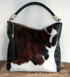 Tas leer met koeienhuid www.zusenzolifestyle.nl