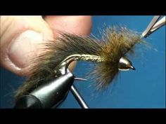 """What a classic.  The Slumpbuster comes for the vise of John Barr.  John's book, Barr's Flies"""" is one of the best fly tying books that I own.  I continually reference his book to refresh my tying skills and get inspiration on creating new fly patterns.      If you want to catch a TOAD, this fly is certainly one to try.  This fly can be effective us..."""
