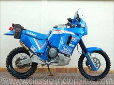 """For the 1991 Paris Dakar Rally, the Yamaha French Importer """"Sonauto Yamaha"""" listed 3 motorbikes in this competition. Those 3 factory motorbikes (A OWC5 for Peterhansel and two OWB8 for Lalay and Magnaldi) will be ridden by desert race specialists such as Stéphane Peterhansel, Gilles Lalay and Thierry Magnaldi. They won the three first places in the general motorbike ranking. The only technical difference between de OWC5 and the OWB8 is in the Kayaba fork, which is a classic one with…"""