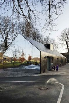 """Funhouse mirrors are mounted on the gabled ends of this playground pavilion in Copenhagen"""