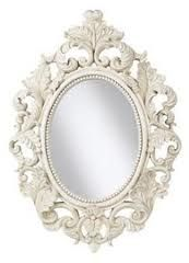 Love the white oval baroque mirrors. For the half bath.