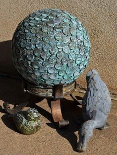 Add patina to a penny bowling ball garden ball by spraying with a mixture of hydrogen peroxide, vinegar and a little salt