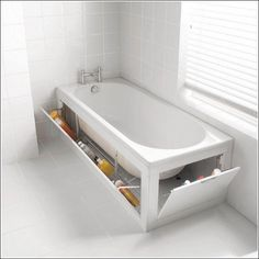 Clever solutions to bathroom problems:  shown--The spaces underneath the bath tub can be a storage area.