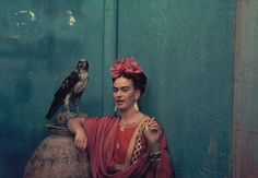 Frida Kahlo, in a Tehuana costume, with her pet hawk, 1939. --- Image by © Condé Nast Archive/CORBIS © Corbis. All Rights Reserved.