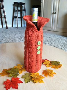 Knitted Wine Bottle Cover - This pattern features cables and is a very quick knit. Perfect for hostess gifts at upcoming holiday parties.