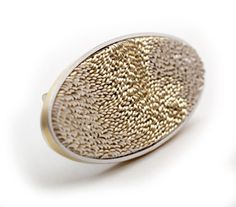 Andrew Lamb  Brooch: Lenticular  18ct yellow gold, silver  photo Graham Clark l EXPO 'Contemporary Jewellery x 4′