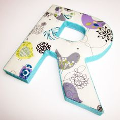 cute for nursery- decopage fabric to letters!