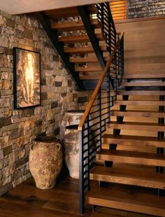 meets rustic in a beautiful Colorado mountain retreat Love these contemporary stairs against the stone wall.outdoorsy in a modern loft kinda way.Love these contemporary stairs against the stone wall.outdoorsy in a modern loft kinda way. Rustic Staircase, Floating Staircase, Staircase Ideas, Staircase Makeover, Industrial Stairs, Staircase Remodel, Railing Ideas, Wooden Staircases, Iron Staircase