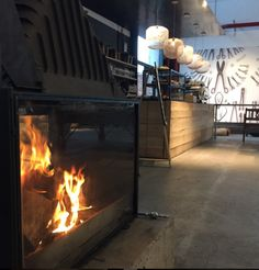 Weylandts: The Kitchen and their double sided fireplace on a block of concrete. This is cool!