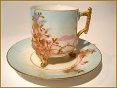PLEASE LOOK AT MY OTHER AUCTIONS FOR MORE ANTIQUE HAND PAINTED PORCELAIN LIMOGES Here is an exquisite Limoges Porcelain 19th Century Footed Demitasse Cup and Saucer Set hand painted with floral and fo
