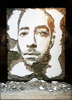 "Street art by Alexandre Farto, aka Vhils'. ""He carves, sculpts, drills, scratches and paints his images onto the wall."""