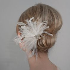 hairstyle but with a flower/brooch and not feathers