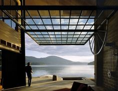 'Chicken Point Cabin' - lakeside cabin designed by architect Tom Kundig. Glass Garage Door, Garage Doors, Glass Doors, Sliding Doors, Large Windows, Windows And Doors, Architecture Details, Interior Architecture, Museum Architecture