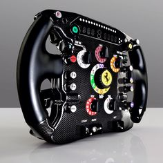 ALONSO'S WHEEL.  Photographed for WIRED UK. by Diver & Aguilar.  The Ferrari 150° Italia  The wheel boasts fully functional KERS, DRS and pit lane limiter buttons Meanwhile, the other switches around the wheel can be used to perform all sorts of tasks from adjusting the brake balance to tweaking the fuel mix. Congratulations to Fernando Alonso,Scuderia Ferrari and all the Tifosi around the world   on winning today's 2012 Formula 1 Petronas Malaysia Grand Prix…