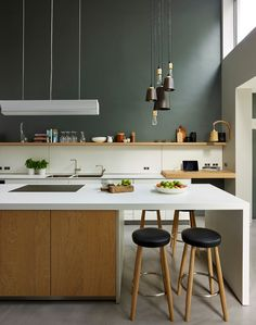 Photo of a contemporary kitchen in London with a double-bowl sink, flat-panel cabinets, light wood cabinets, white backsplash, concrete floors and an island.This is an example of a contemporary kitchen in London.Design ideas for a contemporary kitchen in London.Photo of a contemporary kitchen in London.Contemporary kitchen/dining combo in London with gray walls and concrete floors.Design ideas for a contemporary exterior in London. #kitchen #bath #traditional #contemporary #contractor…
