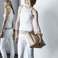 Tip: Go for an all-white look punctuated with neutral, timeless accessories. Add an easygoing braid. Go. #allwhitelooks #easyweekendoutfit #racerbacktank #whitejeans