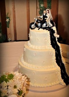 Three tiered cake with original cake topper