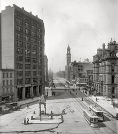 """Circa 1890s. """"Campus Martius, Detroit."""" Down the street, a """"moonlight tower"""" arc-lamp stanchion."""