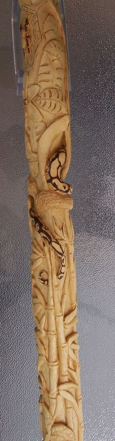 The Rainforest - a hand carved walking stick on Sycamore. Bamboo