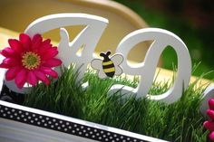 Pink and Purple Bumble Bee Baby Shower centerpieces, name