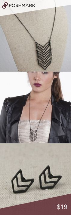 Blackout chevron necklace and earring set After multiple wardrobe changes, you throw on your leather jacket and head out the door for a night out. But when you stop to look in the mirror a final time something's missing. Fill the void with this Blackout Chevron Necklace and Earring Set. The necklace has a long chain that holds up black chevron patterns and the matching black stud earrings add a simple finishing touch. Now you're ready for a good time. Jewelry Necklaces