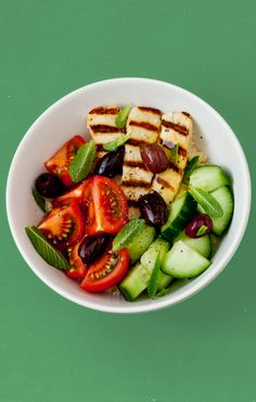 A grain bowl that glows with health. Griddled halloumi is best hot, but it isn't half-bad cold. Mix with mint, olives, grains and veg.