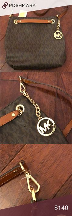 """Michael Kors Purse - Tags still attached! Michael Kors Classic Monogram Purse, called the """"Jet Set Chain Item"""", in the color brown. It comes with crossbody straps to wear multiple ways! This bag matches everything, and even comes with a removable Michael Kors Bah Charm. All original tags are attached where they where when I bought this! Great price! Please let me know if you have any questions and check out the other listings in my closet! Thanks and have a nice days MICHAEL Michael Kors…"""