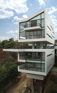 Gaeta Springall Architects project in Mexico City. The project involves two towers that each contain two houses that have been built on the side of a steep ravine.