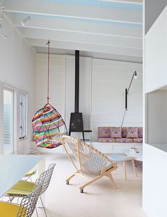 PP130 Circle Chair by Hans Wegner, Shaker wood stove by Antonio Citterio with Toan Nguyen for Wittus, Tropicalia Cocoon hanging chair by Patricia Urquiola.