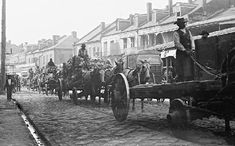 Wagons line up on Decatur Street, waiting to unload their goods at the market, which is just out of the picture, on the left; ca. 1898.
