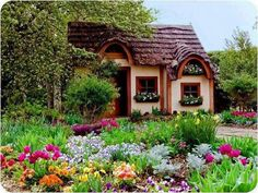 This reminds me of some of the beautiful cottage's that can be found in the English country side!