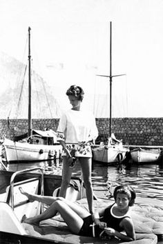 Marella Agnelli and Princess Pignatelli on La Leopolda, one of the Agnelli's yachts, in the port of Beaulieu-sur-Mer on the Cote d'Azur, Vogue, July 1, 1962.  Photo by Henry Clarke.