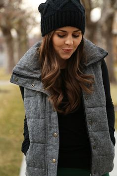 old navy vest and beanie hat