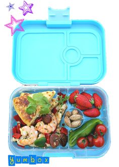 Yumbox packed with Spain inspired ingredients: Spanish tortilla, sauté of turkey breast, chorizo and shrimp, pepper, baby tomatoes, strawberries and almonds.