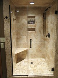 "frameless shower door with inline panel, antique 3/8"" tempered glass, oil rubbed bronze hardware, and no header"