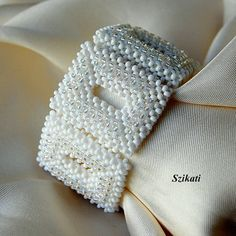 Beaded white seed bead cuff bracelet Right Angle Weave by Szikati,