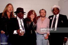 Photo d'actualité : Backstage portrait of, from left, musicians Greg...